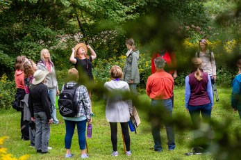 WOODBURY, CT. 23 September 2018-092318 - Kiri Clark, center, in the hat , has everyone meditate using a technique inspired by the Japanese practice of shinrin-yoku, forest bathing, or taking in the forest atmosphere before she leads a group of people in a therapeutic journey through the woods at the Flanders Nature Center Van Vleck Sanctuary in Woodbury on Sunday. Bill Shettle Republican-American