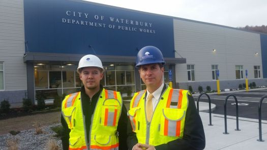 Waterbury Development Corp. Project Manager Santiago Bolanos, left, and WDC Interim CEO James Nardozzi stand outside the nearly complete Department of Public Works headquarters on Monday. WDC provided development and oversight of the project. Michael Puffer/Republican-American