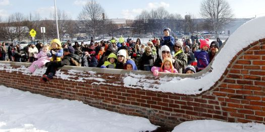 Republican-American archiveEager children and parents listen to the opening ceremonies during last year's Christmas Village kickoff in Torrington. Christmas Village returns for its 71st year on Dec. 9.
