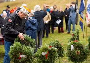 WATERTOWN, CT-121518JS08- Ralph Barbieri, Commander of Oakville VFW Post 7330,, places wreaths in a row during the annual Wreaths Across America ceremony held Saturday at the Old Burying Ground in Watertown. The event was hosted by the Trumbull-Porter Chapter of the Daughters of the American Revolution and the Waterbury Veterans Memorial Committee. Jim Shannon Republican American