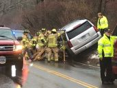 cutline attribution name:Steve Bigham Republican-AmericanWoodbury firefighters work to stabilize a Chevy Tahoe that sits along an embankment after a two-car accident Thursday afternoon.
