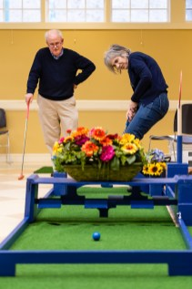 WOODBURY, CT. 15 February 2019-021519 - Maryanne Taylor of Middlebury watches her ball go through the turning obstacle, as her husband Bob looks on, as they play the indoor mini-golf course at the Senior Center in Woodbury on Friday. Bill Shettle Republican-American