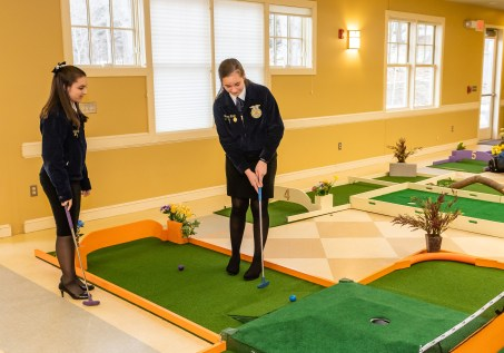 WOODBURY, CT. 15 February 2019-021519 - FFA students of Nonnewaug High School, Olivia Braga of Newtown, left, and Brenna Ritchie of Woodbury play at the indoor mini-golf course at the Senior Center in Woodbury on Friday. Bill Shettle Republican-American