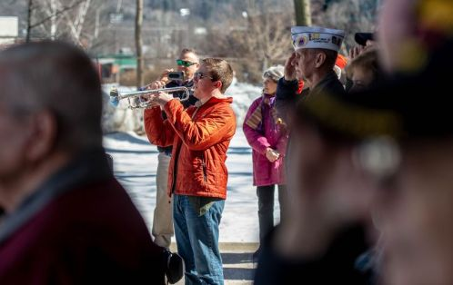 Ashton Tyler, 15, of Boy Scout Troop 3 in Torrington, plays taps during the Torrington Veterans Support Committee's Gulf War Veterans Day Observance Thursday at Coe Park in Torrington. Officials, guests, veterans and current military personnel were on hand to honor veterans of the Gulf War and the War on Terror. Jim Shannon Republican-American