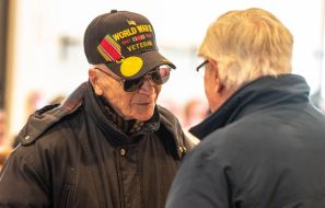 John Mastrocola, left, of Torrington, a Navy veteran of World War II, talks with Korean War veteran Ed Killingbeck of Torrington during the Torrington Veterans Support Committee's Gulf War Veterans Day Observance Thursday at Coe Park in Torrington. Officials, guests, veterans and current military personnel were on hand to honor veterans of the Gulf War and the War on Terror. Jim Shannon Republican-American