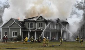 Firefighters from multiple fire departments attack a fire Sunday afternoon that badly damaged the home of Marika and Kim Coolbeth at 17 Tamshell Drive in the Kent Hollow section of town. The family was not home at the time the fire began. Lynn Mellis Worthington Republican-American