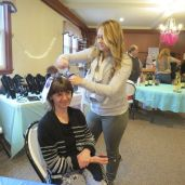 Melissa Pinardi, owner of Stunning Styles in Canaan, gives Helene Minton of Sharon a new hairdo during Vive la Femme. Ruth Epstein Republican-American