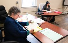 Moderator Karen Pfuger, left, and ballot clerk Christine Reisel work between voters as turnout was light during a referendum on the Region 14 school budget Tuesday at Bethlehem Town Hall. Jim Shannon Republican-American