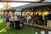 People enjoy themselves at the pavilion on a beautiful spring evening during the Greater Waterbury Campership Fund's Big Green Truck party at Camp Mataucha in Watertown on Thursday. Bill Shettle Republican-American