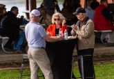 Guests enjoy the high-top tables loaned from the Mattatuck Museum during the Greater Waterbury Campership Fund's Big Green Truck party at Camp Mataucha in Watertown on Thursday. Bill Shettle Republican-American