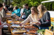 Guests pick from the many varieties of pizza, during the Greater Waterbury Campership Fund's Big Green Truck party at Camp Mataucha in Watertown on Thursday. Bill Shettle Republican-American