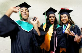 From left, Keven Bruno, 17, Janyra Whitmore, 17, and Jessica Monegro, 18 all of Waterbury celebrate during the Wilby High graduation at the Palace Theater in Waterbury Friday. Steven Valenti Republican-American