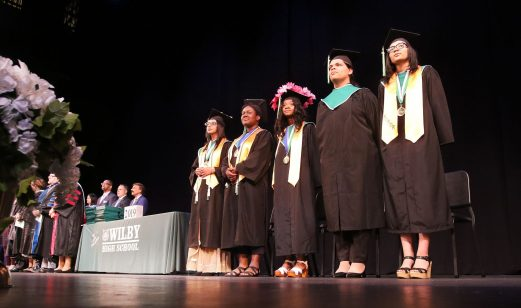 Seniors get ready to graduate during the Wilby High graduation at the Palace Theater in Waterbury Friday. Steven Valenti Republican-American