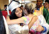 Gail Leon, 18, gets a hug from teacher Stephanie LaBonte during the Wilby High School graduation ceremonies Wednesday in Waterbury. Steven Valenti Republican-American