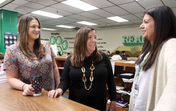Teachers, from left, Krislyn Petti, Amy Frenis, and Marci Hinton meet in the media center at Wilby High in Waterbury Monday. The teachers will be heading to Nepal this summer to learn meditation and other techniques for managing emotions they hope to bring into their classrooms, as recipients of a Fund For Teachers grant. Steven Valenti Republican-American