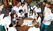 CNA students meet in the media center at Wilby High School in Waterbury Monday. The CNA students are finishing up an illustrated book they will distribute to youngsters in area hospitals. Steven Valenti Republican-American
