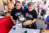 WATERBURY, CT. 12 July 2019-071219 - Joyce Rucci, left, and her sister Joanne both of Wethersfield enjoy the fried dough, during second night of the 81st annual Italian Feast of Our Lady of Mount Carmel at Our Lady at Mount Carmel in Waterbury on Friday. Joyce and Joanne came by bus with other Italian Americans from the Hartford area to enjoy the festival. Bill Shettle Republican-American