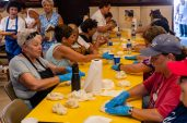 WATERBURY, CT. 12 July 2019-071219 - A team of woman work very hard, each kneading a piece of dough to be put in the hot oil for fried dough, during the 81st annual Italian Feast of Our Lady of Mount Carmel at Our Lady at Mount Carmel in Waterbury on Friday. Bill Shettle Republican-American