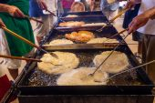 WATERBURY, CT. 12 July 2019-071219 - Large pieces of the ever popular dough, fry in the oil, during the second night of the 81st annual Italian Feast of Our Lady of Mount Carmel at Our Lady at Mount Carmel in Waterbury on Friday. Bill Shettle Republican-American