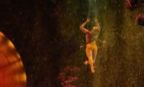 Enya White performs on the trapeze as water rushes down from the top of the big top during Cirque du Soleil's 'Luzia,' which opened June 19 in Hartford. The show continues through July 21.MICHAEL CHAIKEN REPUBLICAN-AMERICAN