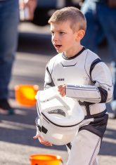 SOUTHBURY, CT. 26 October 2019-102619BS374 - Jack Alesio, 6, of Southbury all decked out in a storm Trooper costume runs to visit friends, during the ninth Annual Trick-or-Treat Spooktacular at the Southbury Center Firehouse on Saturday. The firehouse was transformed into a maze of different themed-rooms where kids could collect treats. Bill Shettle Republican-American