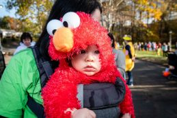 SOUTHBURY, CT. 26 October 2019-102619BS390 - CJ O'Connor, seven months old all dressed up as Elmo waits in line, during the ninth Annual Trick-or-Treat Spooktacular at the Southbury Center Firehouse on Saturday. The firehouse was transformed into a maze of different themed-rooms where kids could collect treats. Bill Shettle Republican-American