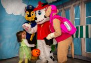 SOUTHBURY, CT. 26 October 2019-102619BS378 - From second from left, Chase, Marshall, and Skye of PAW Patrol, greet Norah Madden, 3, with treats, during the ninth Annual Trick-or-Treat Spooktacular at the Southbury Center Firehouse on Saturday. The firehouse was transformed into a maze of different-themed rooms where kids could collect treats. Bill Shettle Republican-American