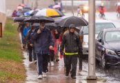 WATERBURY, CT. 27 October 2019-102719BS675 - St. Vincent DePaul Mission Executive Director Gary Beaulieu, left, and Director of Development and Public Relations Edwin Rodriguez, right, lead the walkers down Union Street and through the streets of downtown Waterbury in the pouring rain, during the eleventh annual walk and race fundraiser for the St. Vincent DePaul Mission of Waterbury on Sunday. The Walk took the participants through the St. Vincent DePaul Mission's Thrift Store, Soup Kitchen, and Shelter, the same facilities where the poor receive clothing, food, and a place to sleep, with the guidance of Mission staff. Bill Shettle Republican-American