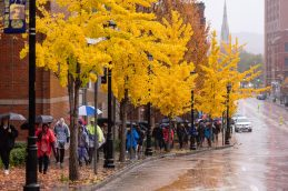 WATERBURY, CT. 27 October 2019-102719BS675 - Walkers walk up East Main Street in downtown Waterbury in the pouring rain, during the eleventh annual walk and race fundraiser for the St. Vincent DePaul Mission of Waterbury on Sunday. The Walk took the participants through the St. Vincent DePaul Mission's Thrift Store, Soup Kitchen, and Shelter, the same facilities where the poor receive clothing, food, and a place to sleep, with the guidance of Mission staff. Bill Shettle Republican-American