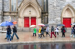 WATERBURY, CT. 27 October 2019-102719BS702 - Walkers walk by the red doors of St Johns Episcopal Church on West Main Street, during the eleventh annual walk and race fundraiser for the St. Vincent DePaul Mission of Waterbury on Sunday. The Walk took the participants through the St. Vincent DePaul Mission's Thrift Store, Soup Kitchen, and Shelter, the same facilities where the poor receive clothing, food, and a place to sleep, with the guidance of Mission staff. Bill Shettle Republican-American