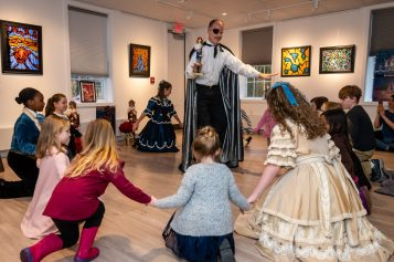 WOODBURY, CT. 24 November 2019-112419BS201 - A member of the Main Street Ballet of Woodbury, center, acts out a scene, during a performance of the popular Christmas Tale the Nutcracker for Children and families at the Woodbury Public Library gallery on Sunday. Bill Shettle Republican-American