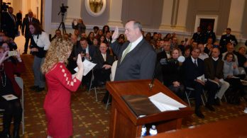Waterbury Mayor Neil M. O'Leary was sworn in for his fourth term by his daughter, Maggie O'Leary, during the inauguration for newly elected and re-elected officials Sunday at Waterbury City Hall. Jim Shannon Republican-American