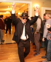 Gary Zeller of Litchfield enters the ballroom at the Litchfield Inn to lead his group's performance during the Possum Queen Contest and Auction on Wednesday. John McKenna Photo