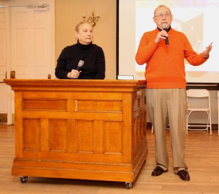 Charles D. Gill and Anne C. Dranginis, former Litchfield Superior Court judges, auction off the witness stand from the old Litchfield courthouse during the Possum Queen Contest and Auction at the Litchfield Inn on Wednesday. John McKenna Photo