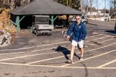 WATERBURY - Dave Bizzozero walks from his car to the first tee ready to play January golf on another warm day at the Waterbury Country Club on Sunday. Temperatures reached into the 60s for the second day in a row. Bill Shettle Republican-American