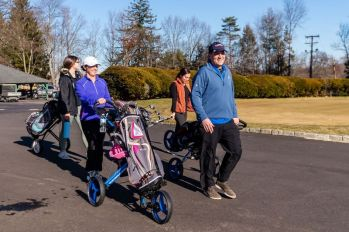 WATERBURY - David Rotatori of Naugatuck, right, leads his wife Pam, second from left, and their daughters Alena, left, and Cara, second from right, to the first tee on another warm day for a family day of golf at the Waterbury Country Club on Sunday. Temperatures reached into the 60s for the second day in a row. Bill Shettle Republican-American