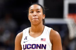 Connecticut's Megan Walker returns to the game with a swollen eye in the fourth quarter of an NCAA college basketball game against Cincinnati, Thursday, Jan. 30, 2020, in Storrs, Conn. (AP Photo/Jessica Hill)