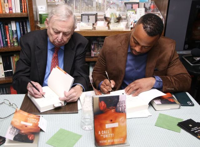 cutline attribution name:photos by John McKenna Republican-AmericanRetired Superior Court Judge Charles D. Gill, left, and Wayne Reid sign copies of their new book at Hickory Stick Bookshop in Washington Depot.