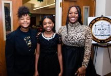 """Samaia Brantley, 13, Destinee Hendricks, 11, and Nadia French-Graham, 18, were the greeters at the """"Men with a Purpose"""" luncheon, a Dr. Martin Luther King, Jr. event celebrating men, at Grace Baptist Church in Waterbury. The event was sponsored by the Waterbury NAACP Youth Council.Jim Shannon Republican-American"""