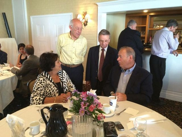 Raymond 'Brook' Colangelo, former co-owner of Dick's Restaurant, second from right, talks with members of the restaurant's scholarship committee, including Richard L. Zaharek, right, David J. Frauenhofer and Adele Zaharek in 2015. A scholarship funded by the restaurant will continue to help students pay for college after it was added to the Torrington Chapter of UNICO scholarship applicants. Republican-American archive