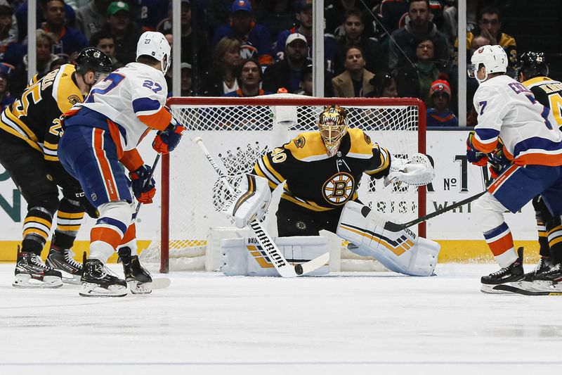 Boston Bruins goaltender Tuukka Rask makes a save during the first period an NHL hockey game against the New York Islanders, Saturday, Feb. 29, 2020, in Uniondale, NY. (AP Photo/John Minchillo)