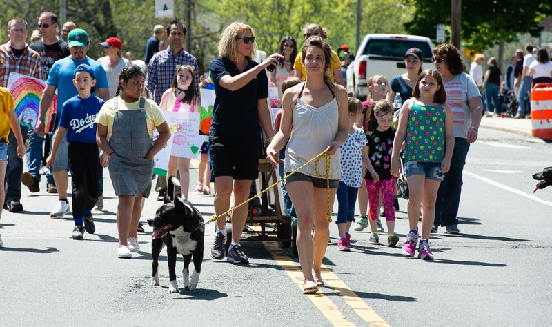 Participants march down Main Street in Winsted during last year