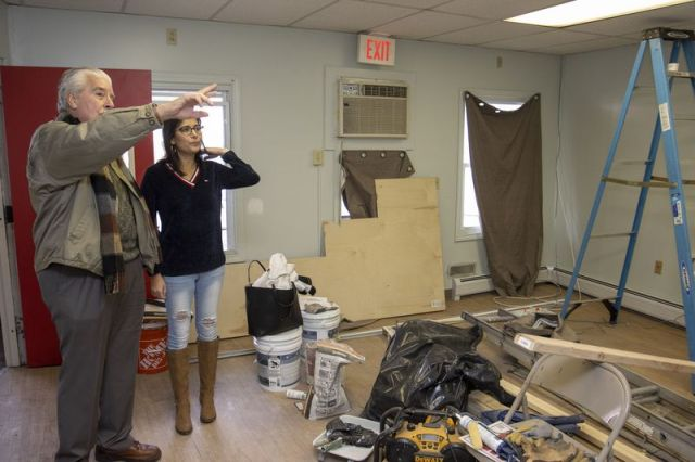 WATERBURY, CT - 29 FEBRUARY 2020 - 022920JW10.jpg -- Building owner Ralph Monti talks with Program Director, Belinda Arce-Lopez about some of the renovations that will happen that will allow the CHD Hospitality Center to move into it's new home Saturday morning. Jonathan Wilcox Republican-American