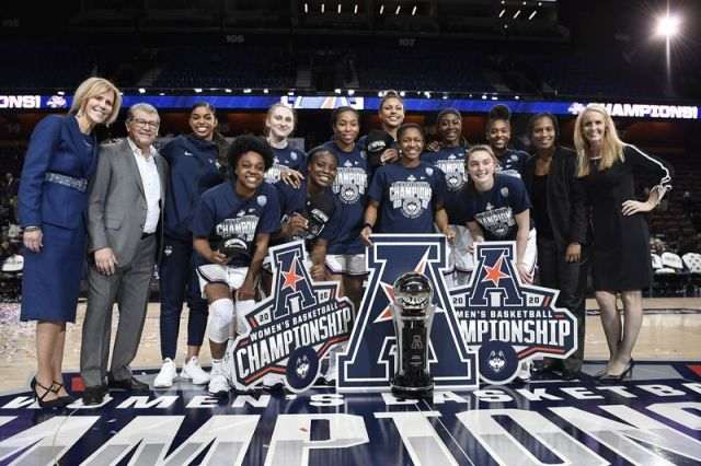 Connecticut poses for a team photo at the end of an NCAA college basketball game against Cincinnati in the American Athletic Conference tournament finals at Mohegan Sun Arena, Monday, March 9, 2020, in Uncasville, Conn. Connecticut defeated Cincinnati in the finals. (AP Photo/Jessica Hill)