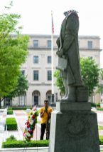 Micah Small of Waterbury, takes video after someone removed the head of the Christopher Columbus statue in front of Waterbury City Hall in the early hours of Saturday. Jim Shannon Republican-American