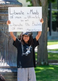 Zechariah Bradshaw, 8 of East Hartford, attended the March for Liberty and Justice For All with his family on Saturday at city hall in Waterbury. More than 100 people participated in the march from Waterbury City Hall to the Green. Jim Shannon Republican-American