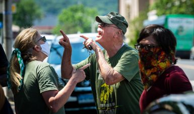 A Vietnam Veteran, upset with the vandalism of the Christopher Columbus statue in front of Waterbury City Hall overnight, clashes with those attending a March for Liberty and Justice For All rally and march to the Waterbury Green from City Hall, Saturday. Jim Shannon Republican-American