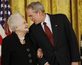 On Nov. 17, 2008, U.S. President George W. Bush greets actress Olivia de Havilland as he presented her with the 2008 National Medals of Arts, in the East Room of the White House. De Havilland, a two-time Oscar-winning actress, has died, aged 104 in Paris. (Associated Press)