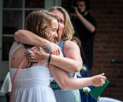 Chase Collegiate graduate Margaret McGuire of New Milford, gets a hug from her mother Dierdre McGuire, Head of Lower and Middle School at Chase, after receiving her diploma during graduation ceremonies Friday at Chase Collegiate in Waterbury. Jim Shannon Republican-American