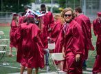 Naugatuck High School graduate David Green celebrates his classmates following graduation ceremonies Friday at Naugatuck High School. The school held five separate ceremonies with about 40 graduates at each due to limitations on gatherings. Jim Shannon Republican-American